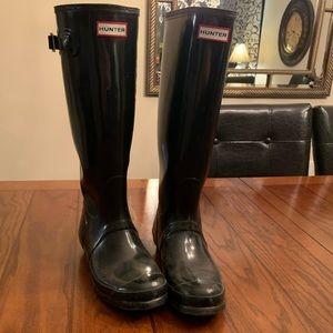 Black tall hunter boots